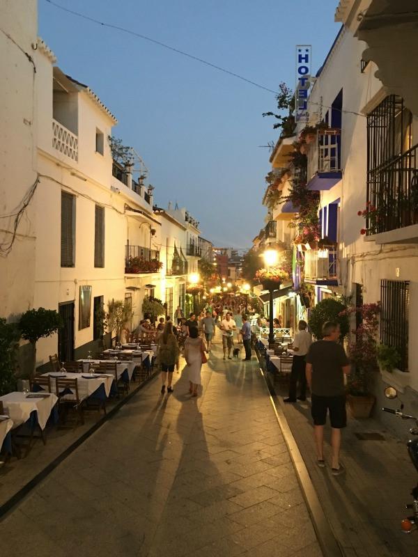 old town marbella street lit at night