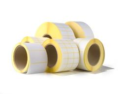 Sticky label rolls on white background.