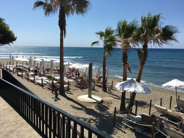 hotel fuerte marbella beach club & lounge chairs on the beach