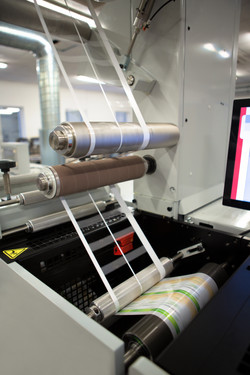 Close-up shot of labels manufacturing on flexo printing machine