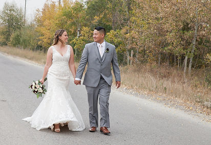 Bride and Groom at their fall wedding in Calgary at Blue Devil golf course