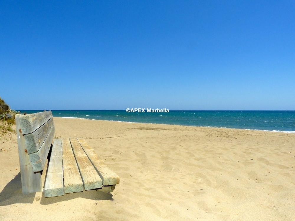 The golden sandy beach of Elviria, Marbella.