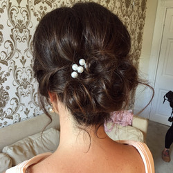 Bridesmaid's messy updo by Alice