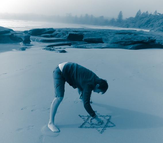 Tanran reiki symbol on the beach
