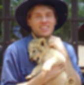 Stephen Shaw cuddling a lion cub