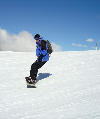 Stephen Shaw snowboarding in St Foy, France