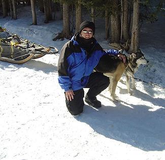 Stephen Shaw dog-sledding in Bannff, Canada
