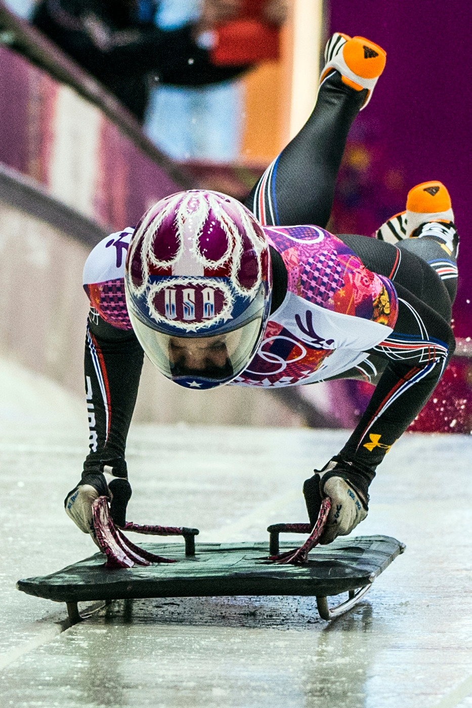 Noelle loading on her sled at the Sochi Olympics