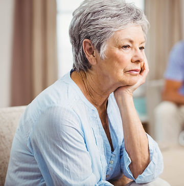 elderly woman with worried face, thoughtful look