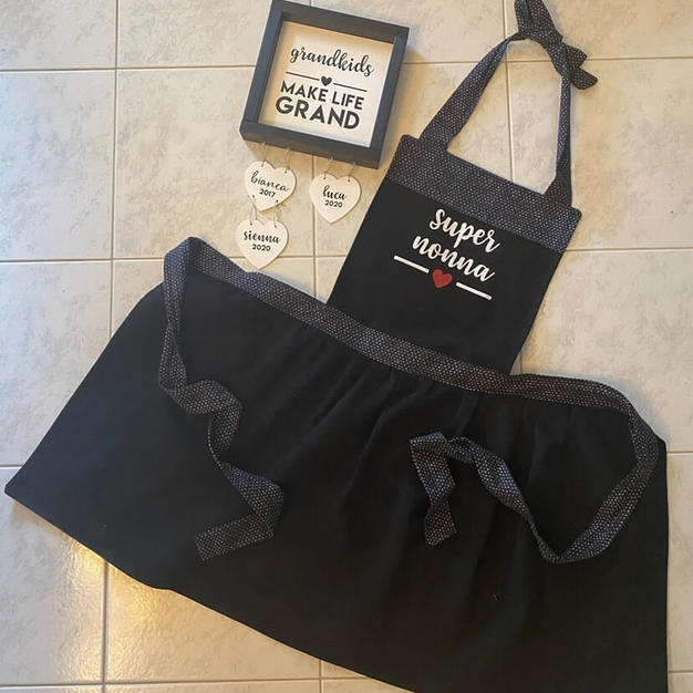 Matching custom apron and framed wood sign