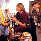 Brett works in his home painting studio.