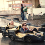 Paul Newman and Brett race on a slick track at Paul's 60th Birthday party.