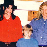 Brett, with his son Stason, introduces Michael and Lisa-Marie Presley in his Los Angeles home in 1992.