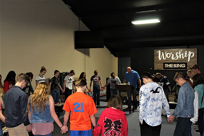youth group with worship sign .JPG