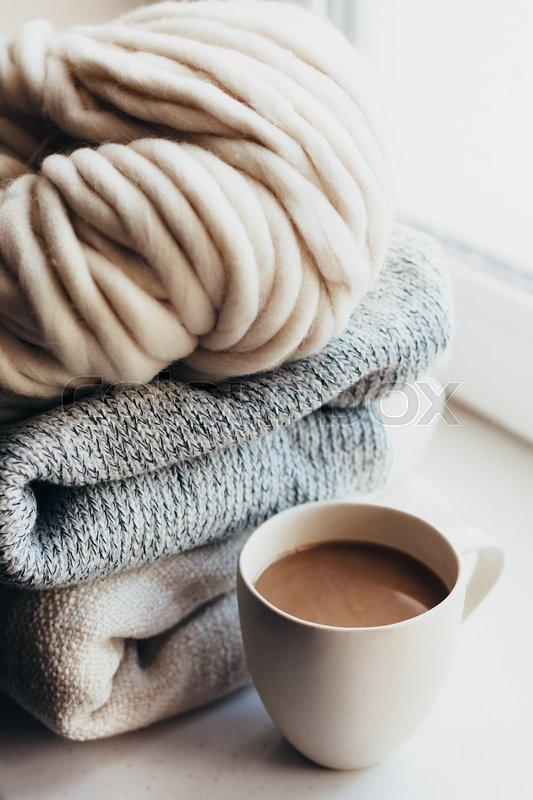 22237188-winter-knitting-by-the-window.j