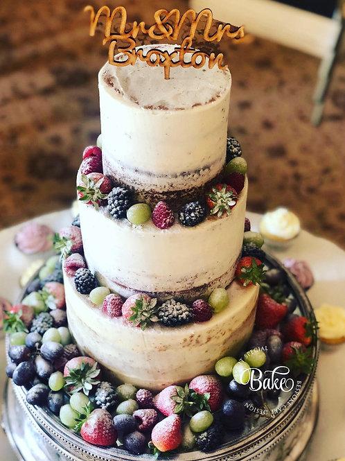 Small 3 tier semi naked wedding cake