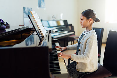 beautiful girl playing the piano at the