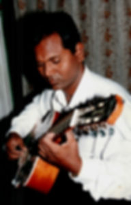 Philip playing classical guitar