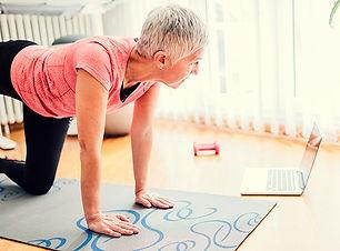 woman-attending-an-online-yoga-class700-