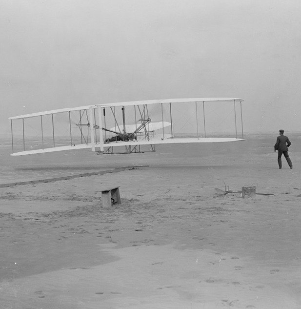 """The Wright Brothers successful flight of the Wright Flyer at Kitty Hawk, NC, after declaring """"success assured"""""""