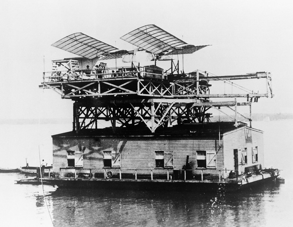 Samuel Langley's Aerodrome ready to launch from a house boat on a river... success was not assured