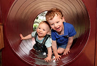 Canva - Young Brothers Playing.jpg