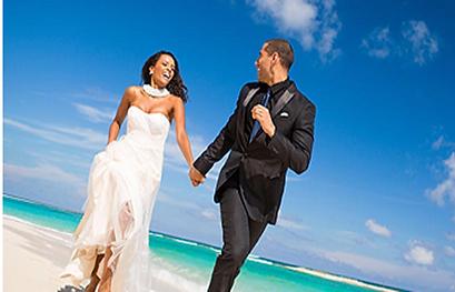 Sandals Bride & Groom running on beach