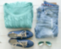 Canva - set of folded women clothes on w