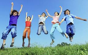 KIDS Jumping in Grass.jp2