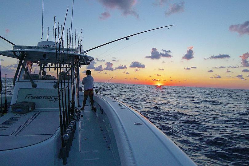 andre on boat sunset.jpg