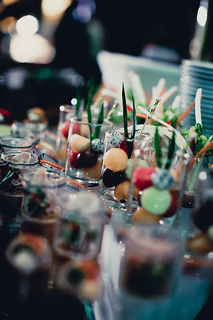 Wedding desserts in glasses with fruit melon balls sorbet and herb garnishes
