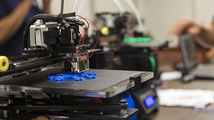 3D Printer at Conexus printing blue shape