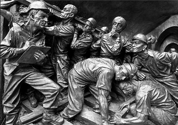 metal sculpture of men working, mining in Lancaster County