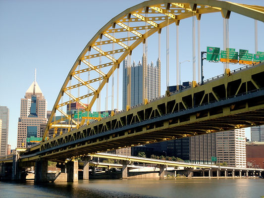 Fort Pitt Bridge Pittsburgh with street signs and highmark building
