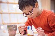 pottery painting boy.jpeg