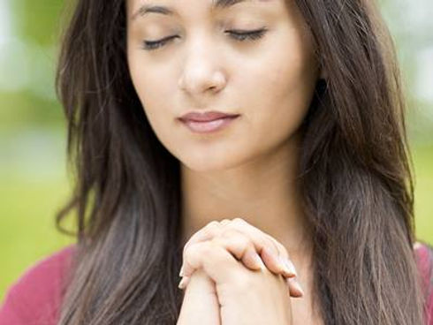 WomanPrayingcreditShutterstockcom.jpg
