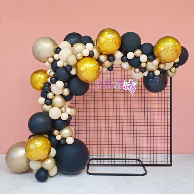 Black Mesh Backdrop with Gold, Black and Nude Balloon Garland