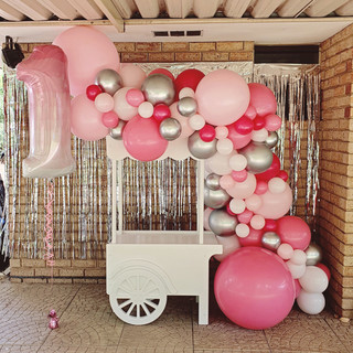 Junior Loll Cart with balloon garland in Pinks, White and Chrome Silver