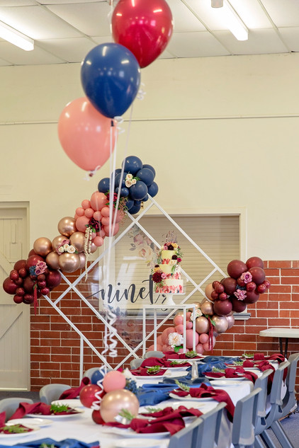 Table helium balloons with balloon base and colour blocked balloon garlands