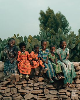 Young girls on a stone wall (CW).jpg