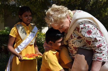 Christel De Haan with school kids.JPG
