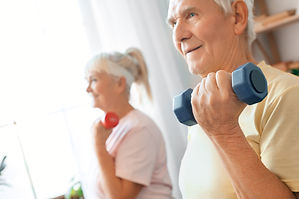 Senior couple exercise together at home