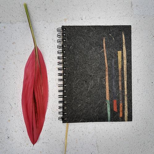 Caderno médio com pauta