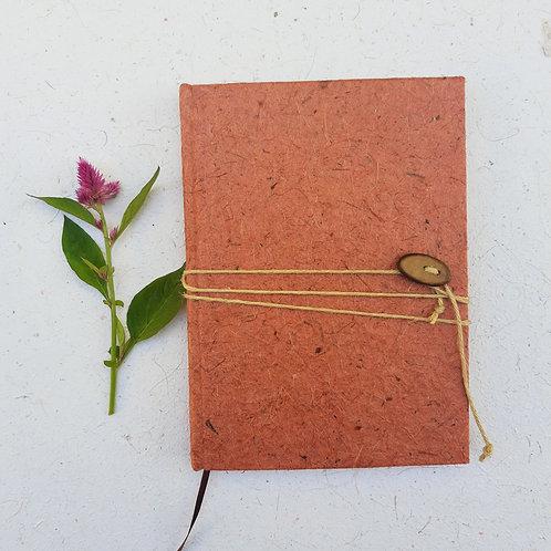 Caderno costurado médio