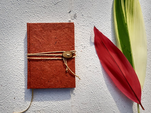 Caderno costurado pequeno