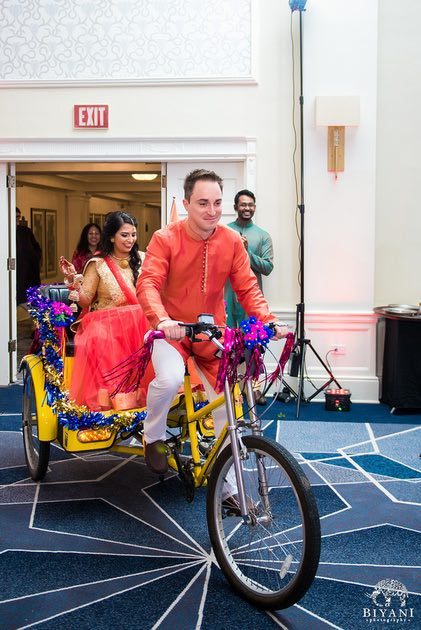Bride and Groom making their entrance in to the reception on a pedicab