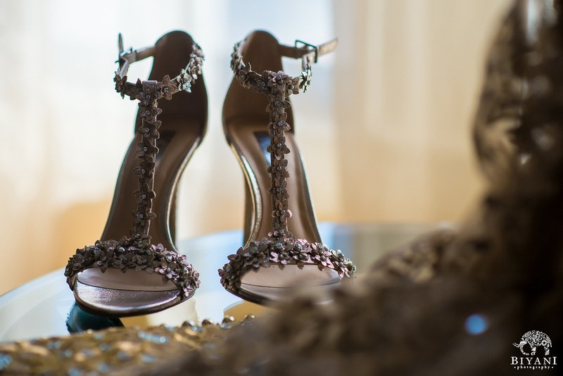 A picture of the Bride's rose gold sandal stilettos.