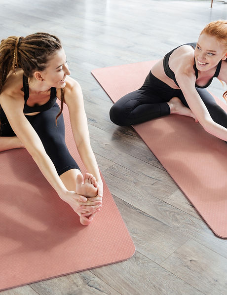 Stretching on Yoga Mat_edited.jpg
