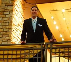 Aaron on balcony.jpg