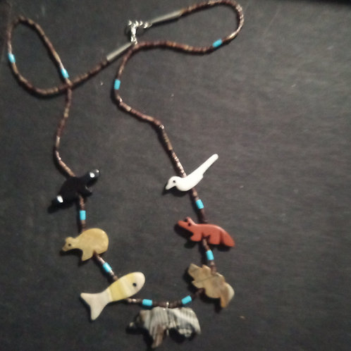 Hand carved  animal necklace